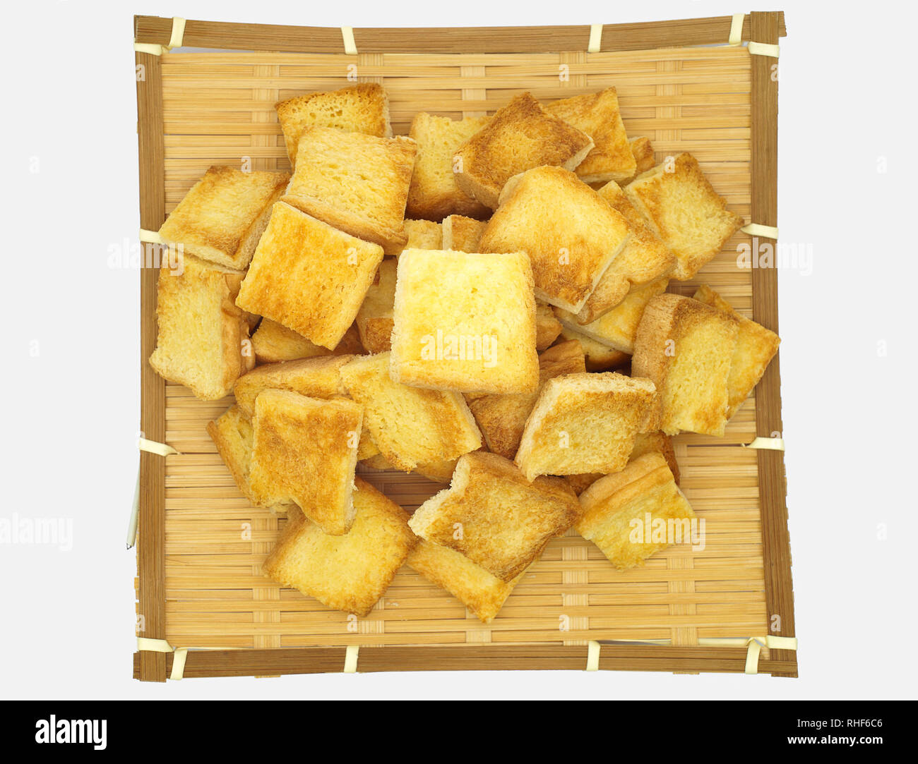 Toast bread on the bamboo fabricate.Isolated on white background. - Stock Image