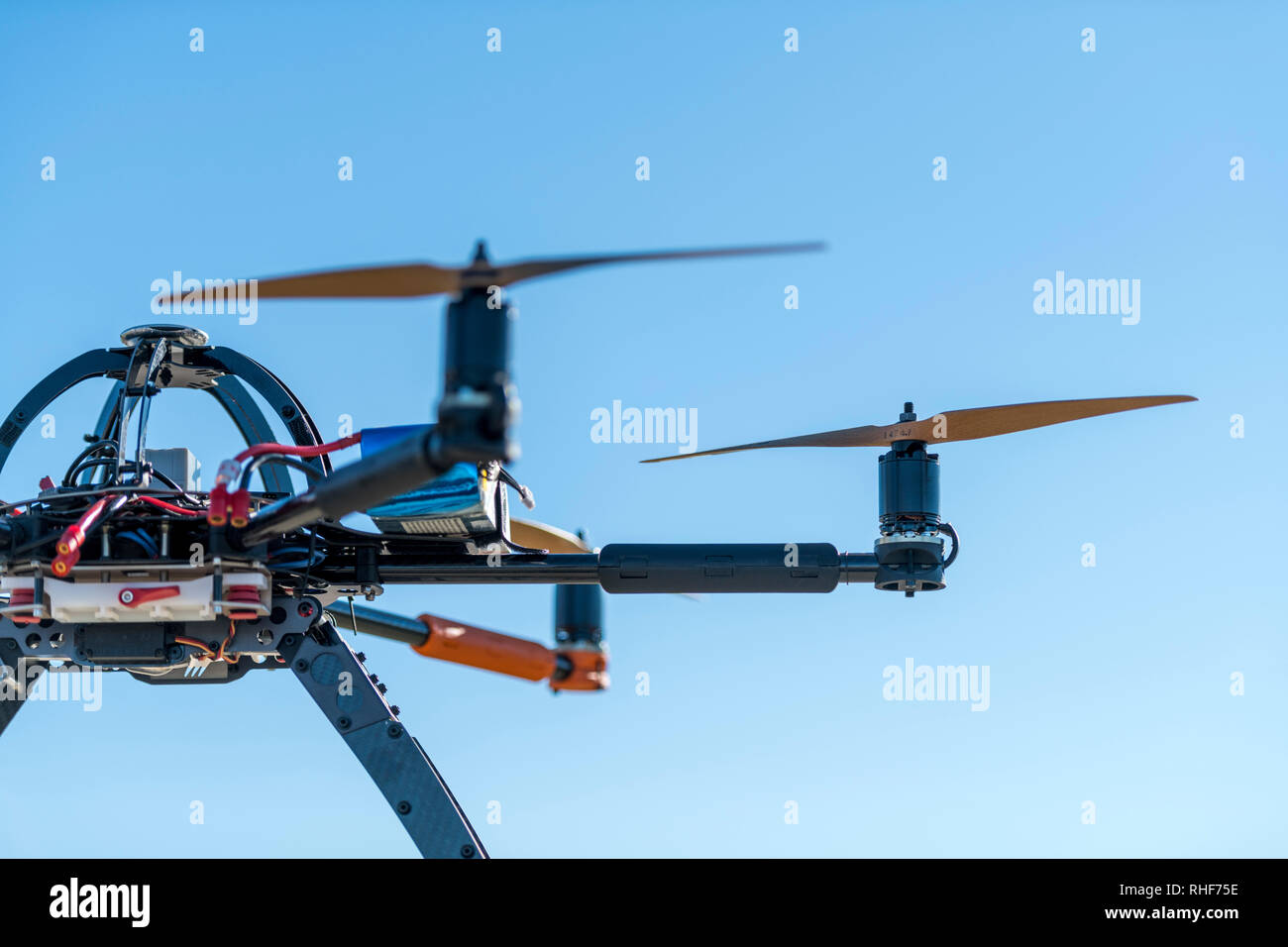 Professional drone ready for a testing flight in sunny day - Stock Image
