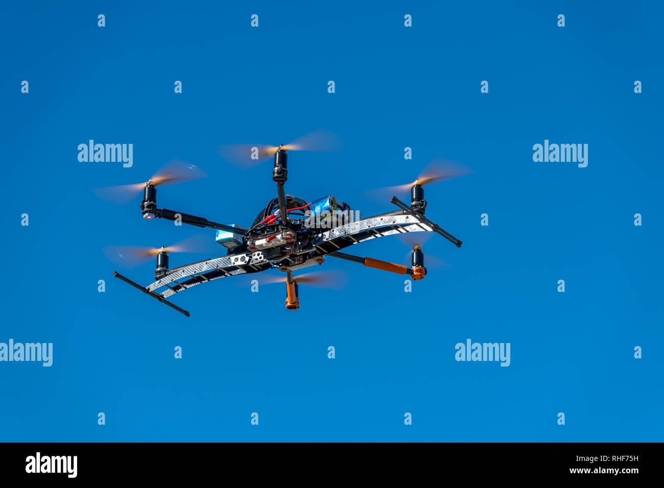 Professional drone flying over the airfield in hover - Stock Image
