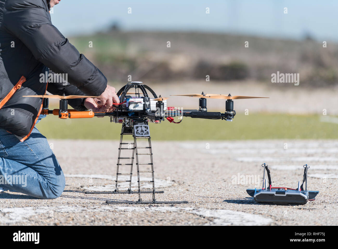 Professional drone being connected before a flight session - Stock Image