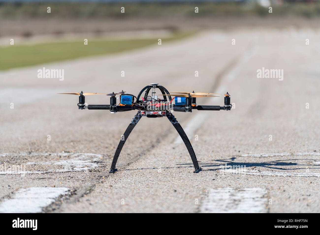 Professional drone standing ready for take off - Stock Image