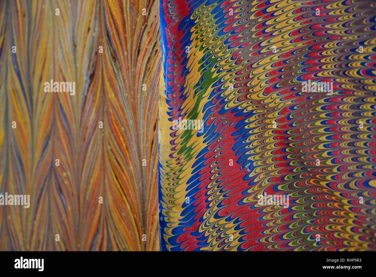 Amazing vivid colors and contrasting patterns on this shop displayed paper creates a stunning background. - Stock Image