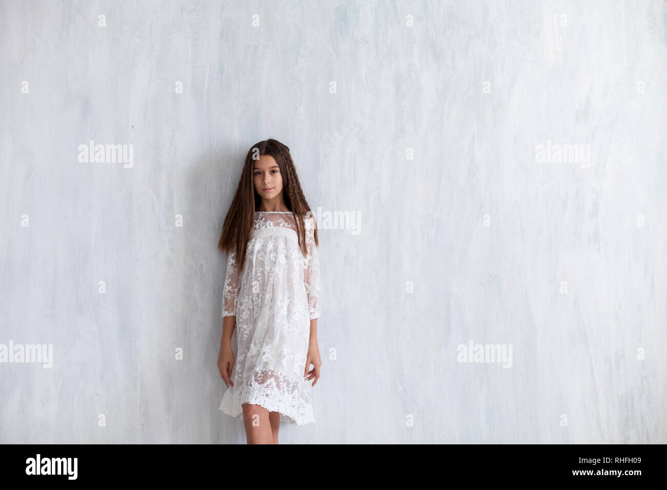 fashion girl 12 years old in a white dress - Stock Image