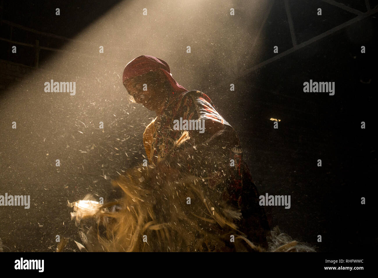 DHAKA, BANGLADESH - JANUARY 24 : Women working in dust environmentinside at jute processing mill near Dhaka, Bangladesh on January 24, 2019. Stock Photo