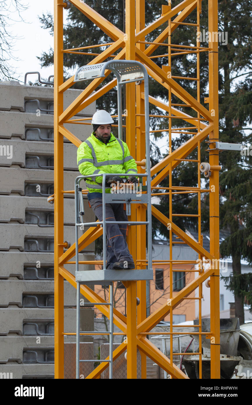 Neuwied, Germany - February 1, 2019: a crane operator is actuating his crane  with a remote control - Stock Image