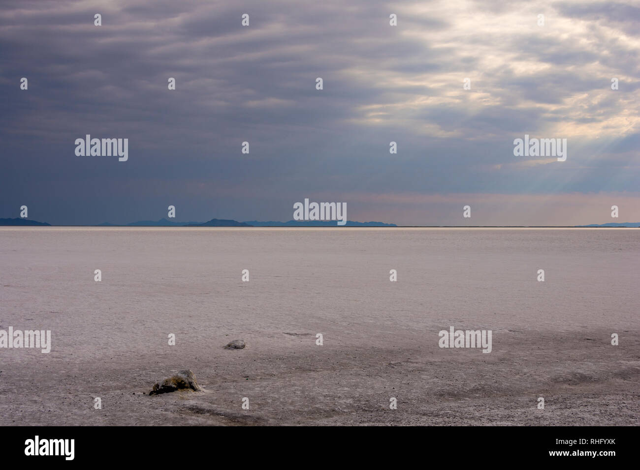 Clouds gathered over Bonneville Salt Flats in Utah, United States on a sunny day. Stock Photo