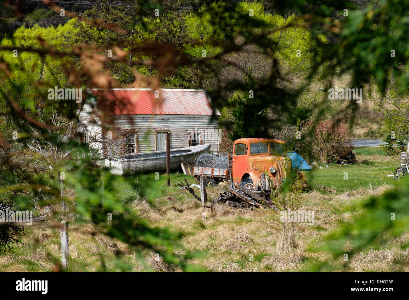 Vintage car next to farmhouse in South Island, New Zealand Stock Photo