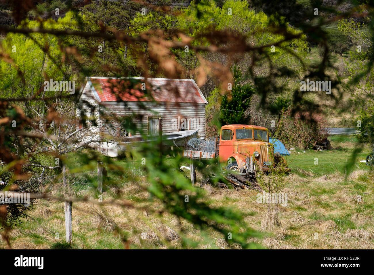 Vintage car next to farmhouse in South Island, New Zealand Stock Photo