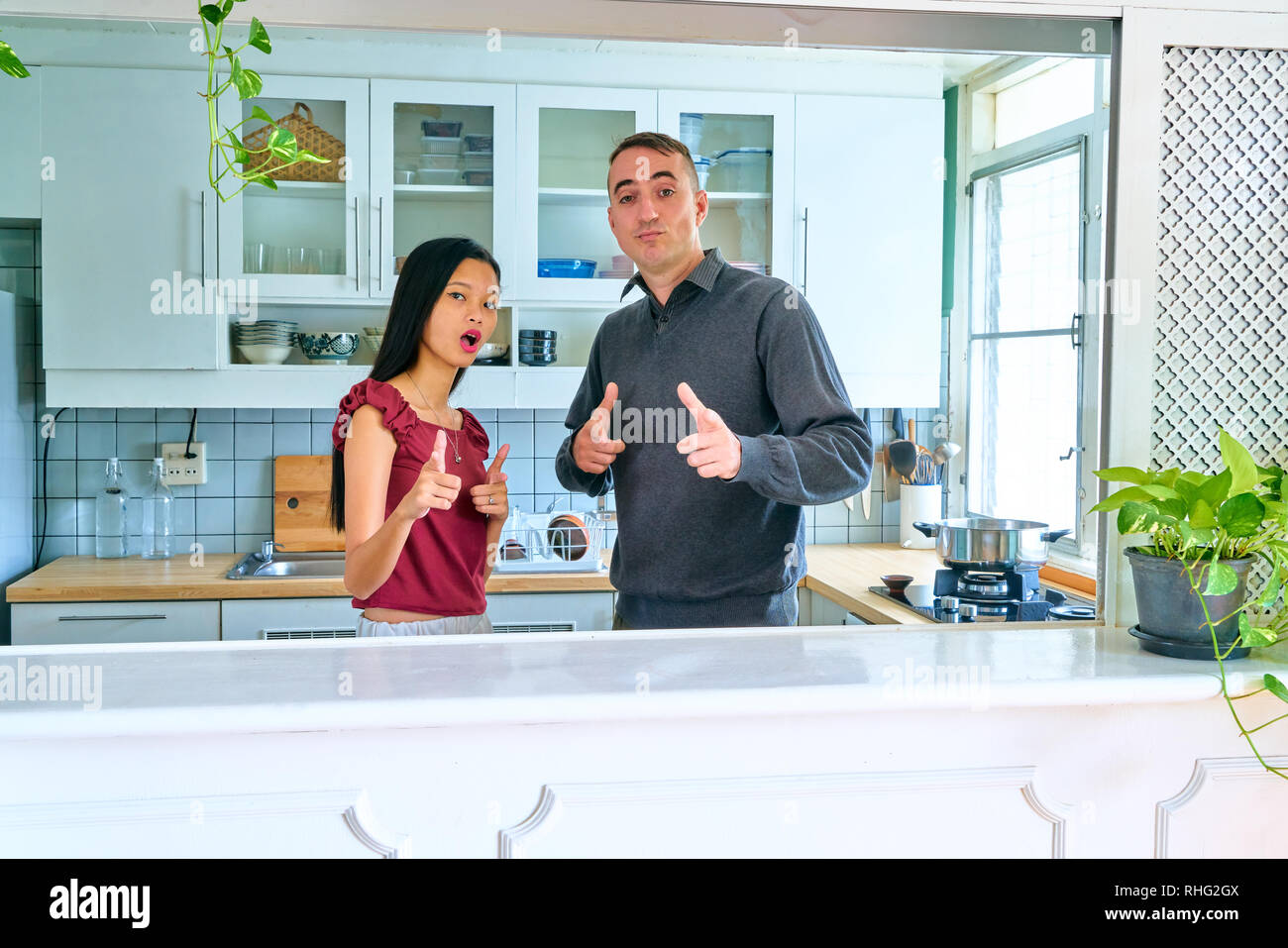 Lovely couple posing - pointing at camera - Stock Image