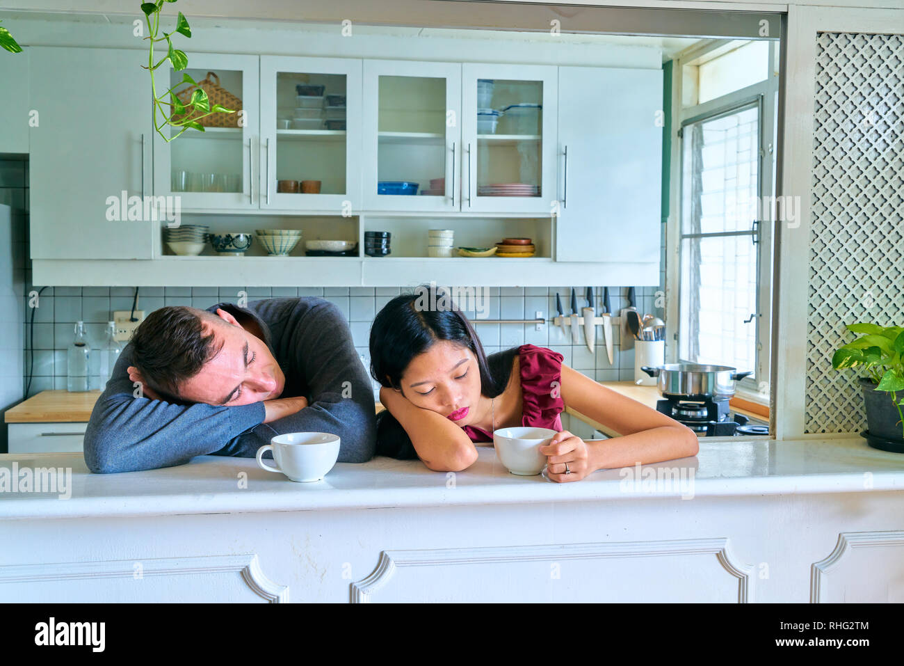 Lovely couple posing - sleeping and tired - Stock Image