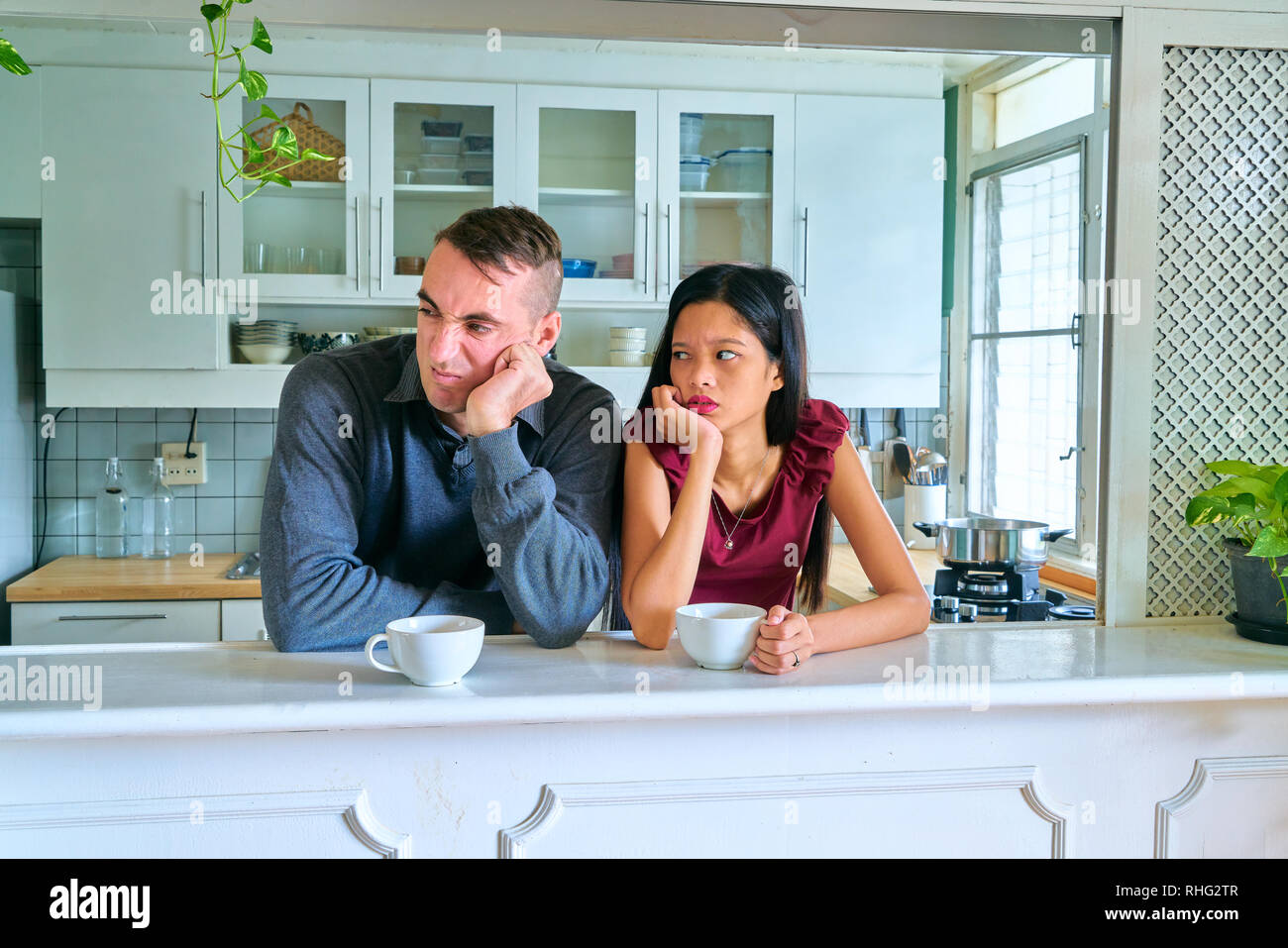 Lovely couple posing - staring and arguing - Stock Image