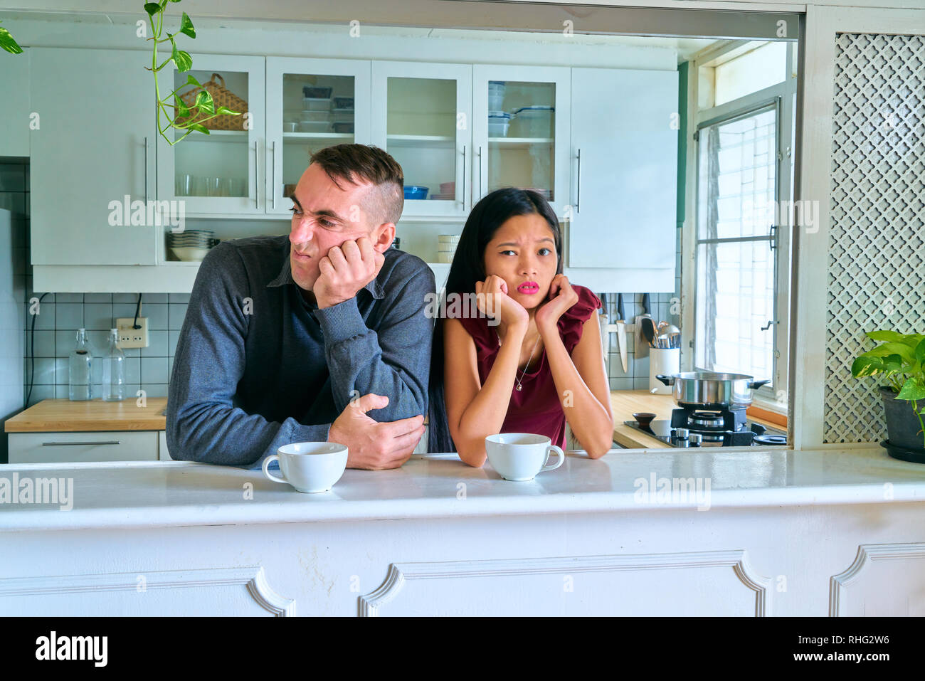 Lovely couple posing - fighting each other and misunderstanding - Stock Image