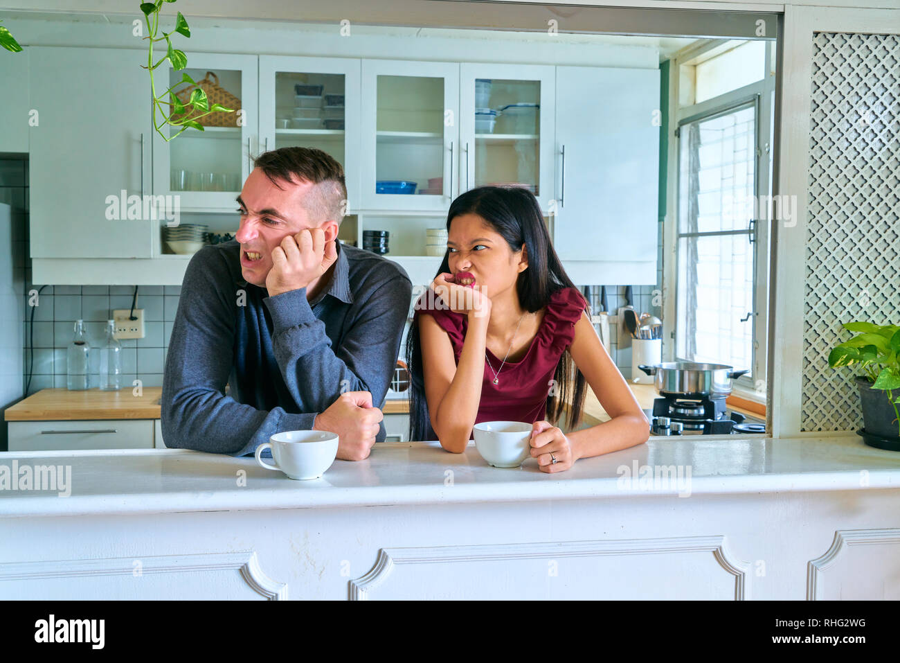 Lovely couple posing - arguing and ignoring - Stock Image