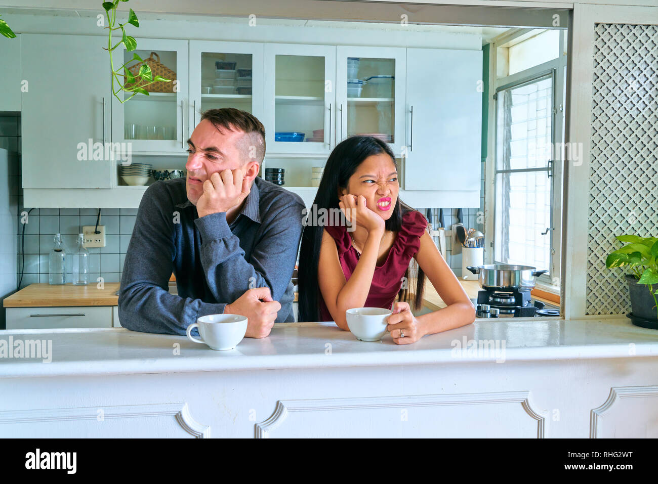 Lovely couple posing - ignoring each other - Stock Image