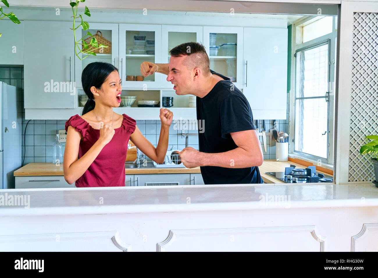 Lovely couple posing - fighting each other - Stock Image