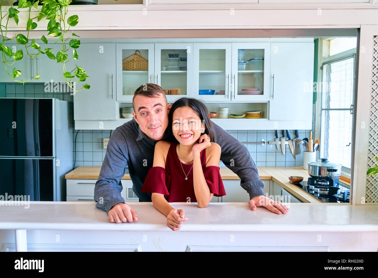 Lovely couple posing - looking at camera and smiling - Stock Image