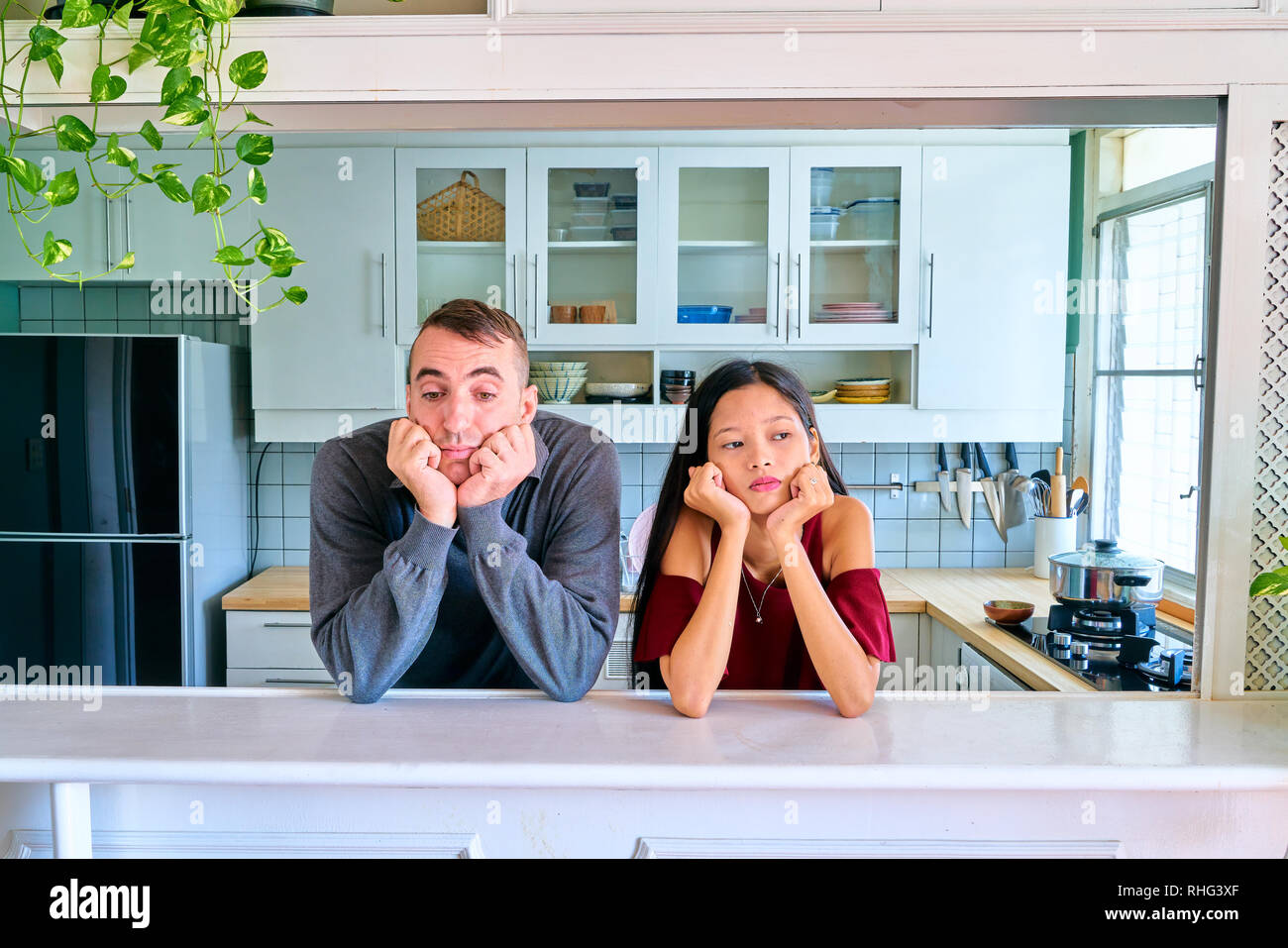 Lovely couple posing - bored and tired - Stock Image