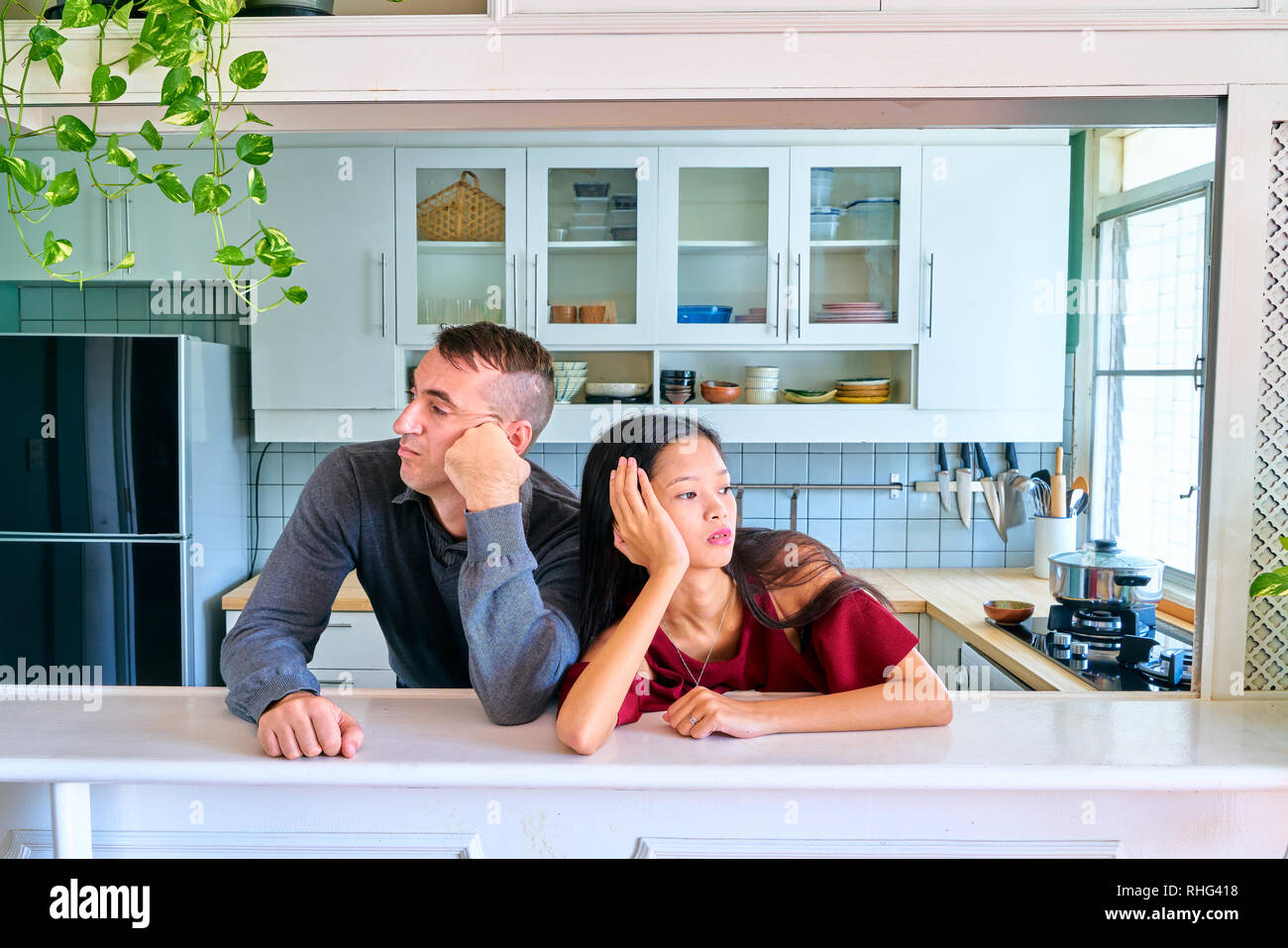 Lovely couple posing - ignoring each other and looking away - Stock Image