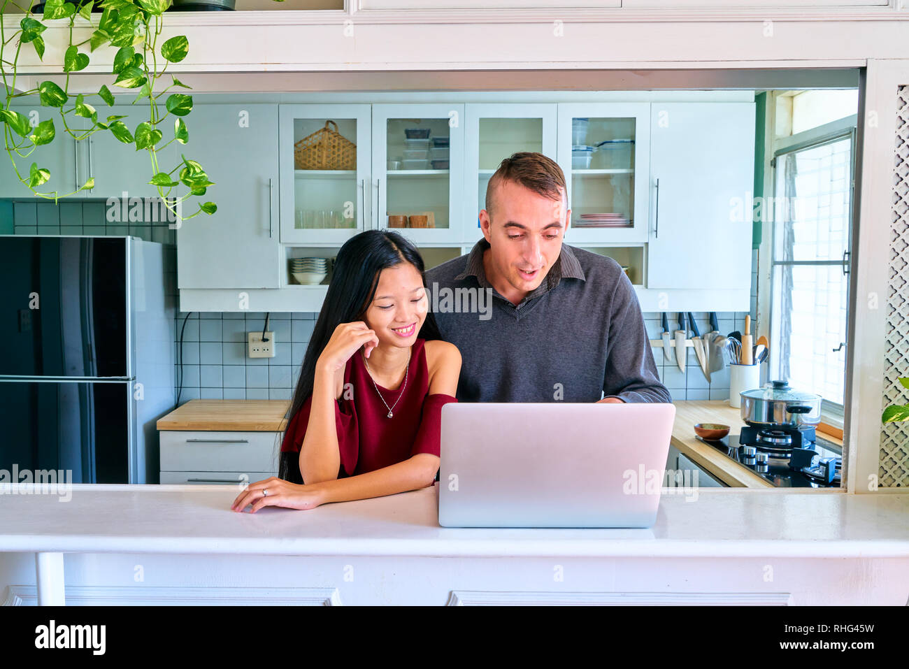 Lovely couple posing - watching movies on laptop and enjoying - Stock Image