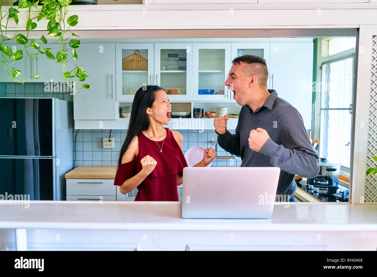 Lovely couple posing - arguing each other - Stock Image