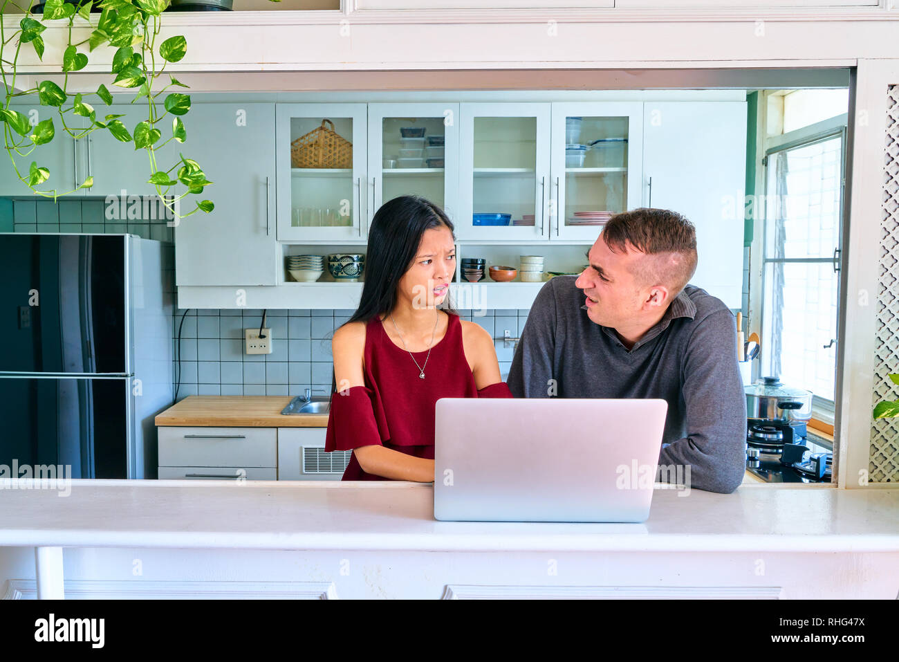 Lovely couple posing - confuse and arguing - Stock Image