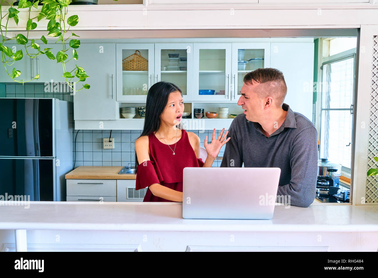 Lovely couple posing - arguing and serious - Stock Image