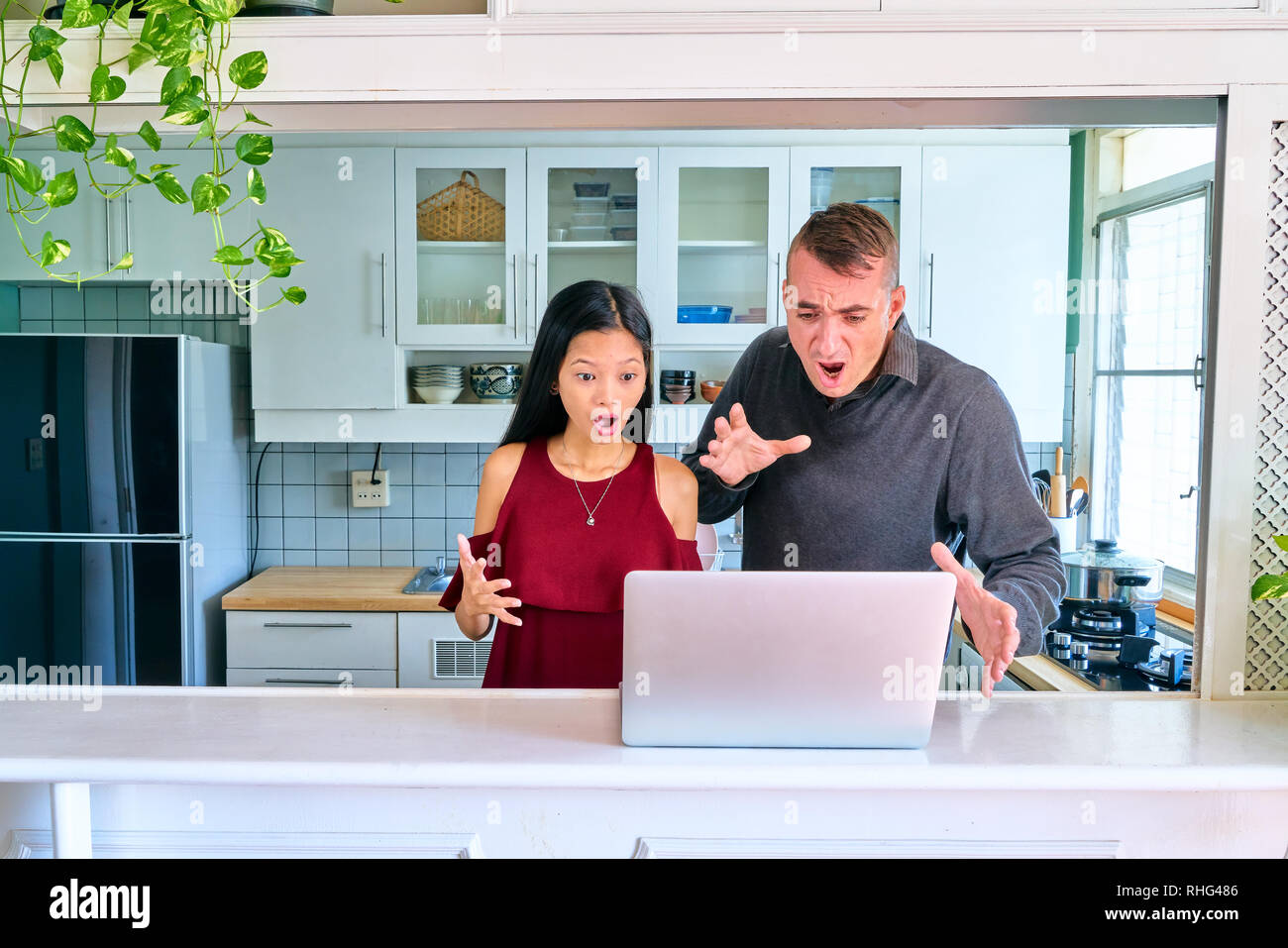 Lovely couple posing - shocked and confused - Stock Image