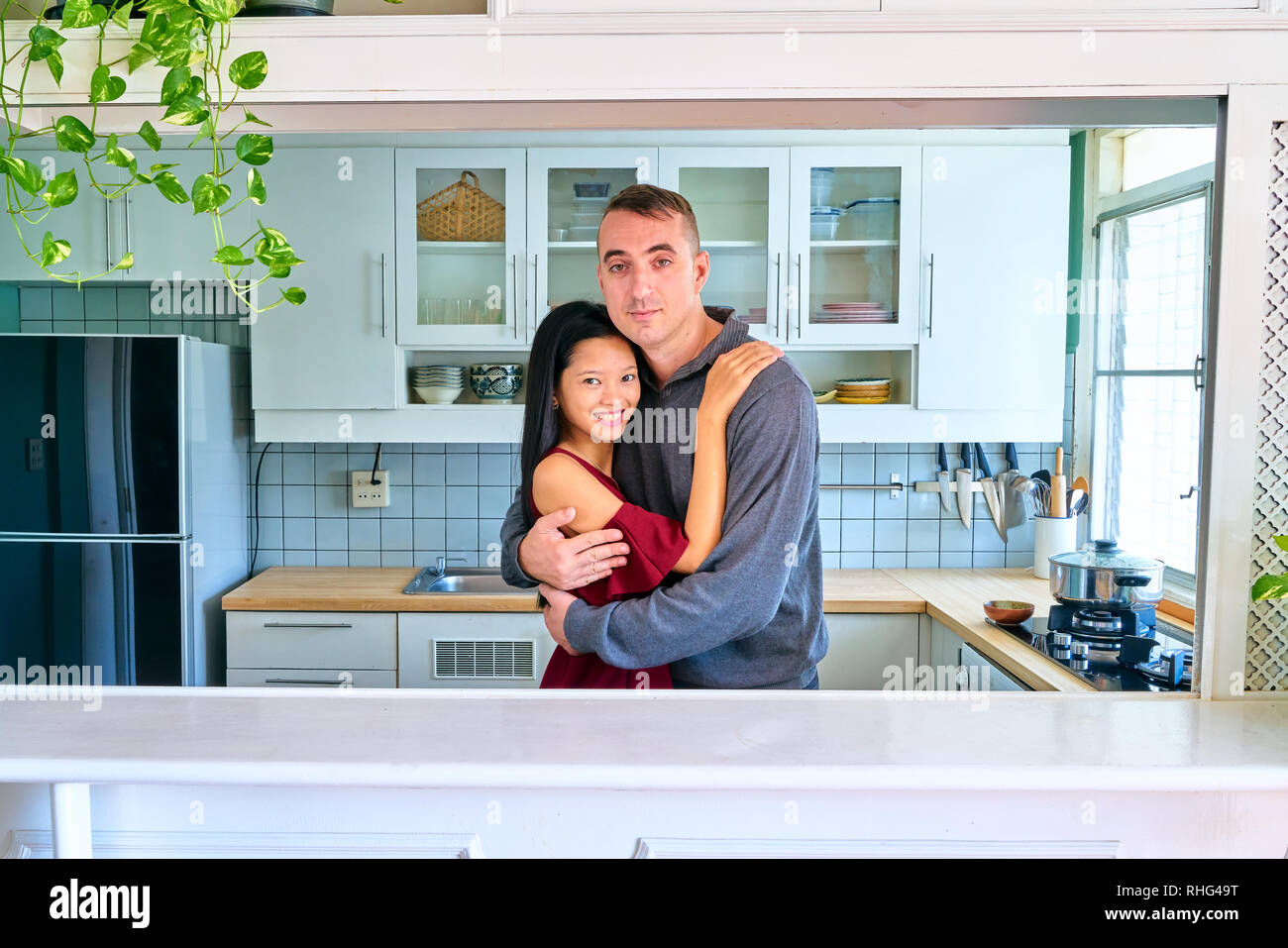 Lovely couple posing - hugging and looking at camera - Stock Image