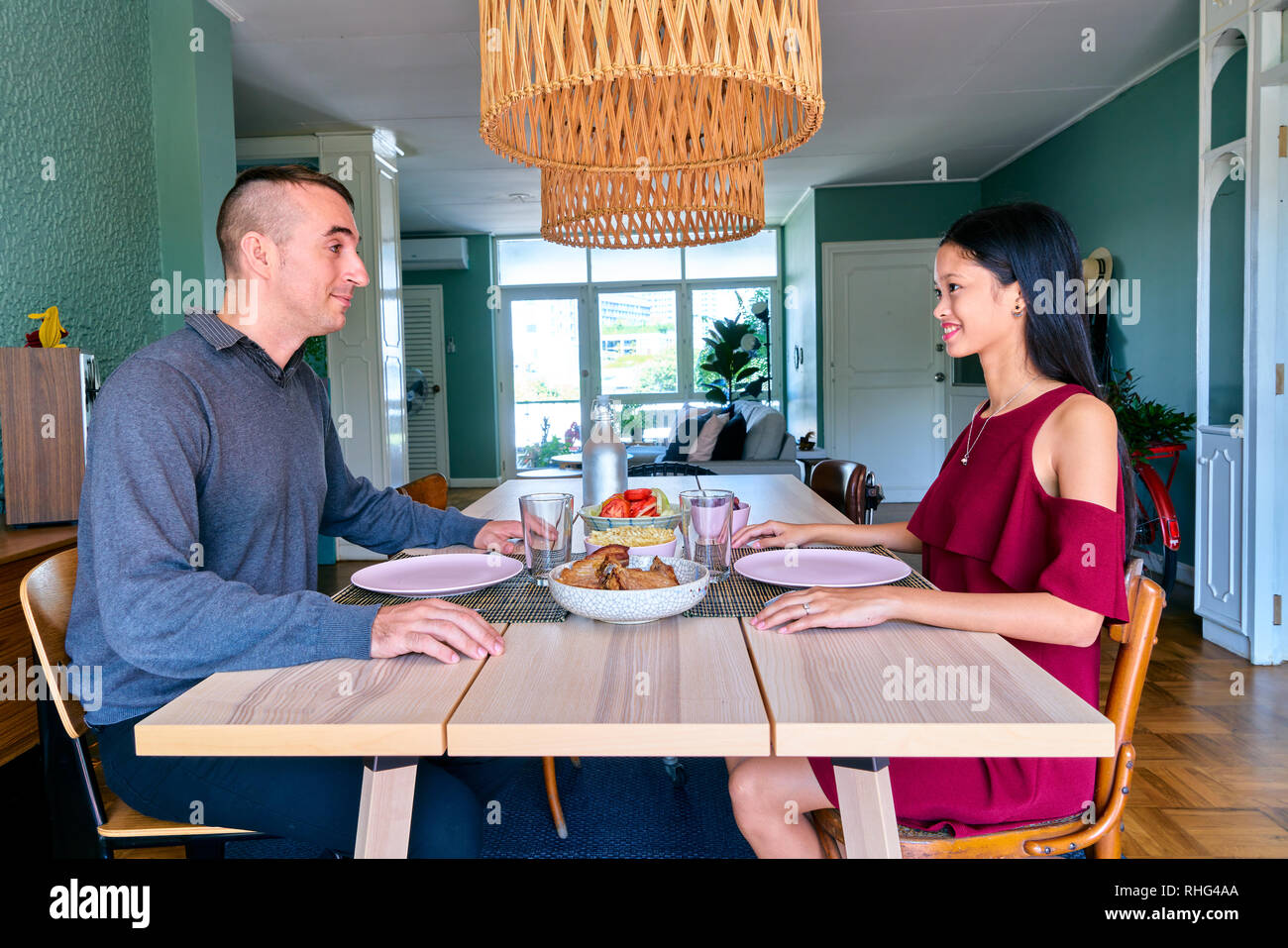 Lovely couple posing - staring each other and dating - Stock Image