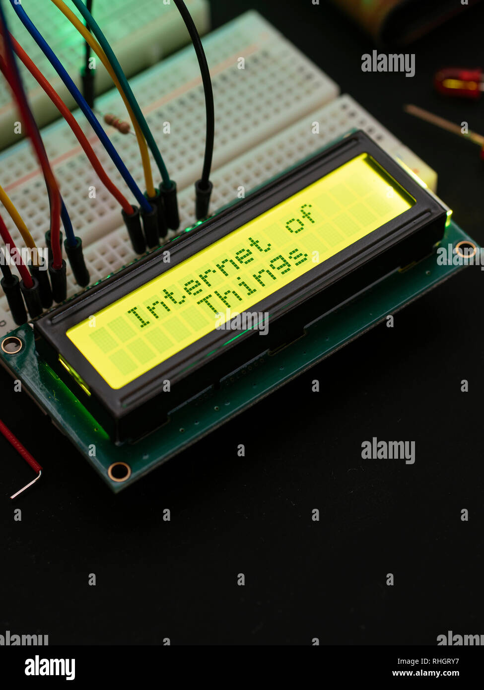 LCD display connected to a microcontroller displaying the text 'Internet of things'. - Stock Image