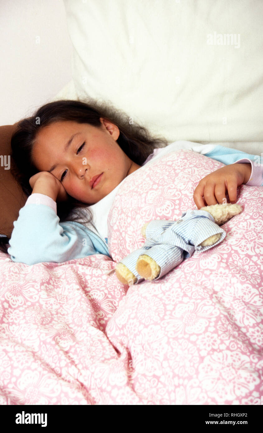 little girl ill in bed - Stock Image