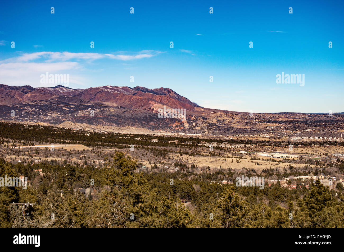 View looking west from Colorado Springs, Colorado on a winter day towards the Rocky Mountain foothills - Stock Image