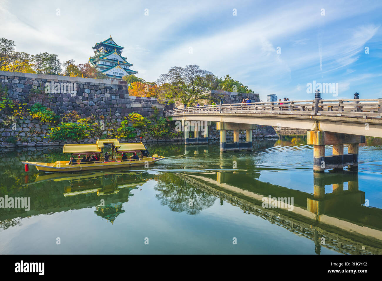 Osaka Castle, a tourist boat in the moat - Stock Image