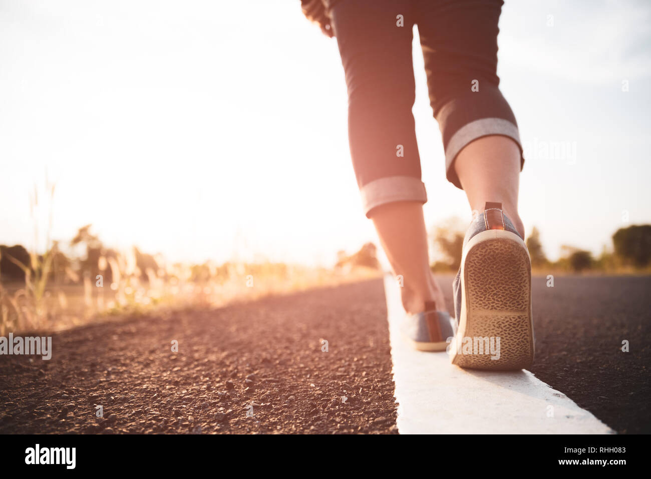 Closeup woman walking towards on the road side. Step concept. Stock Photo