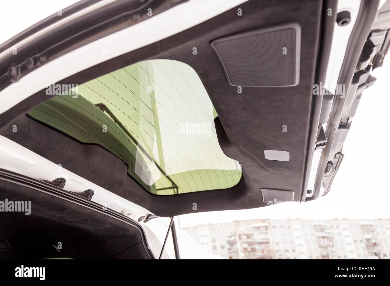 The trunk interior of the SUV car pulled by black soft material alkantara in the workshop for tuning and styling - Stock Image
