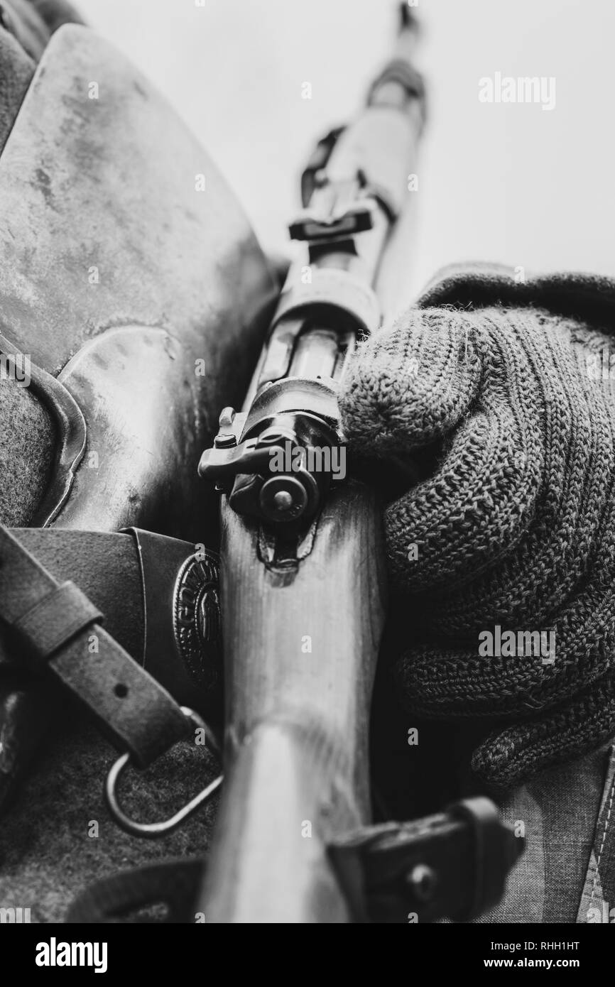 Mauser shutter rifle close-up in the hands of a soldier - Stock Image