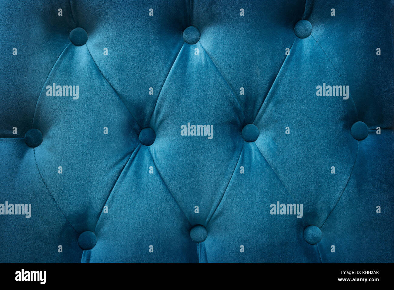 Quilted velvet blue fabric as a background Stock Photo