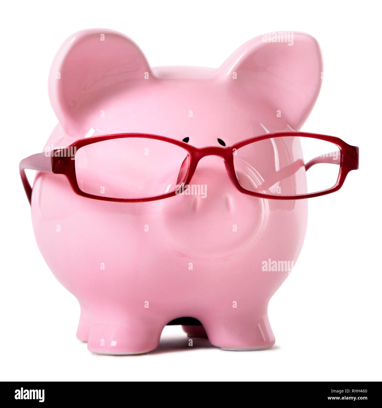Pink piggy bank wearing glasses - Stock Image