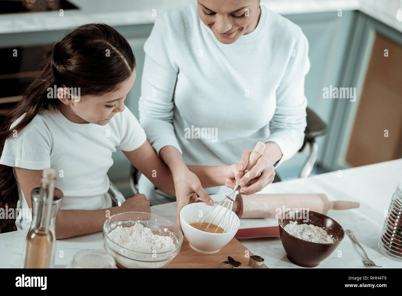 Careful mother opening cooking secrets to the daughter - Stock Image