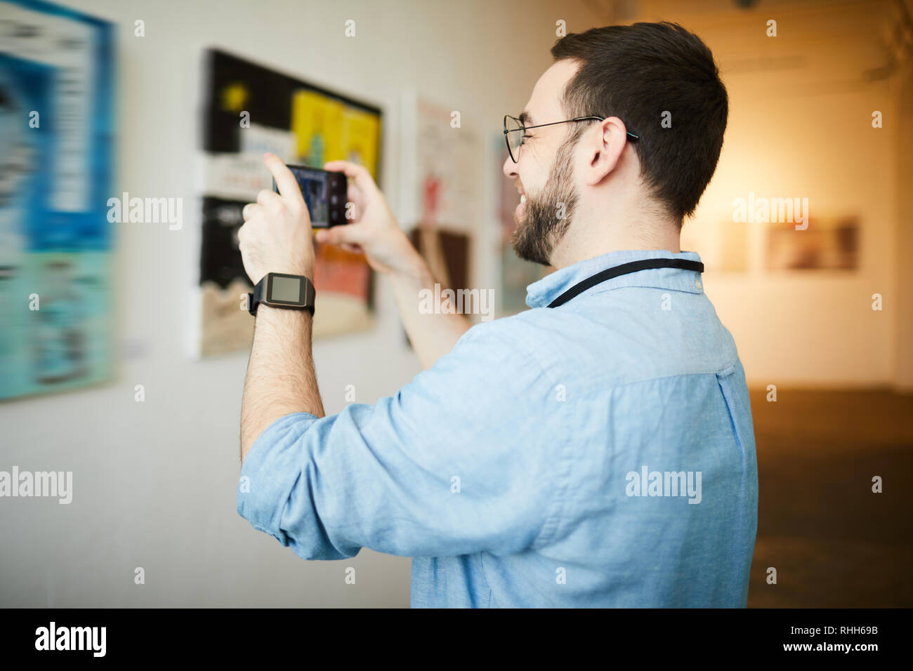 Museum Visitor Taking Photo of Painting - Stock Image