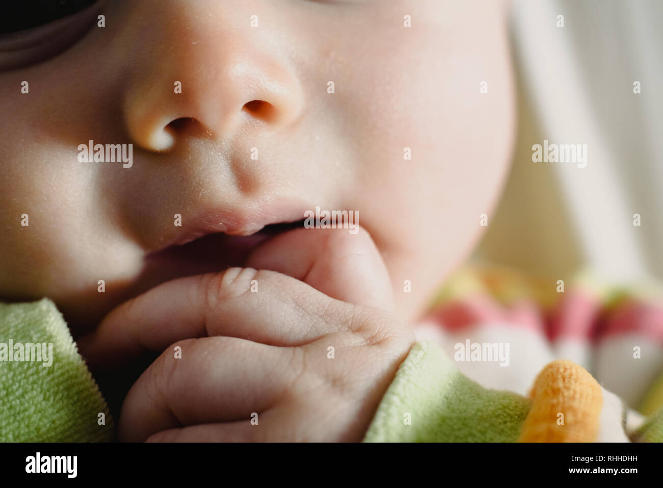 Close-up of the face of a worried baby, macro portrait. - Stock Image
