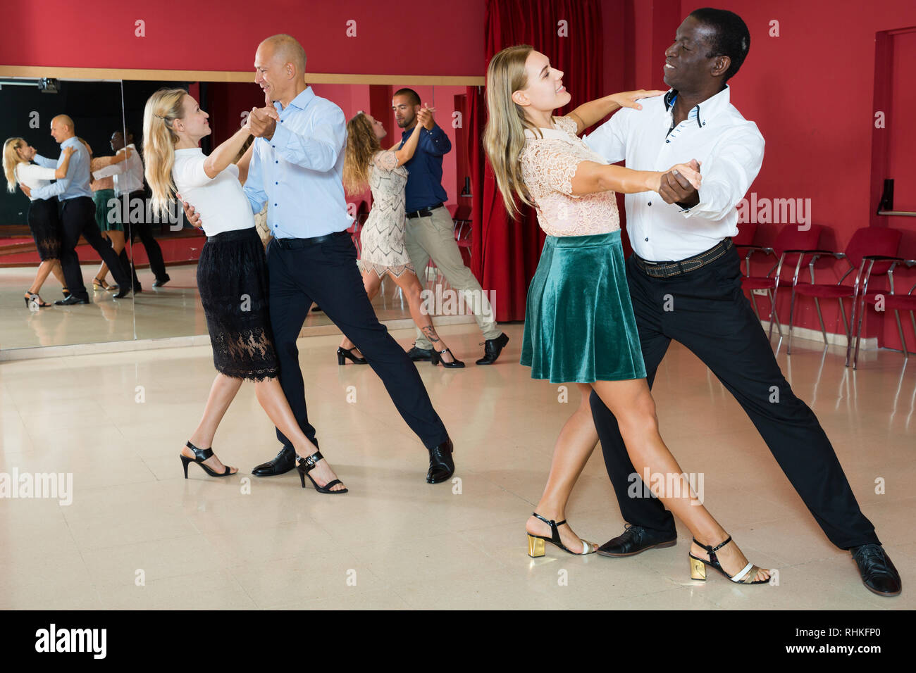 Young Positive People Dancing Together Slow Ballroom Dances In Pairs Stock Photo Alamy