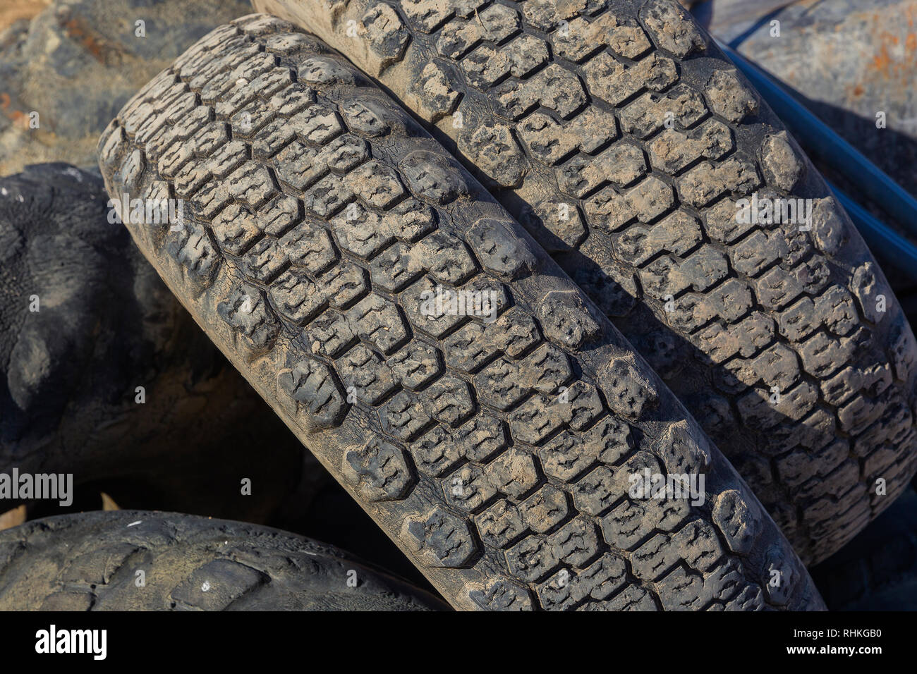 Old tires thrown in a pile - Stock Image
