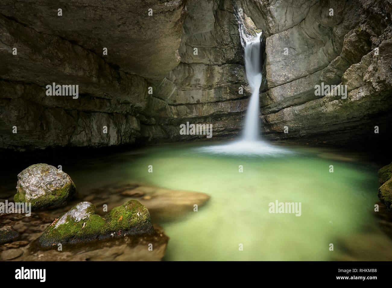 Torrente Boite, near Cortina d'Ampezzo, Dolomites, Veneto, Italy.  Waterfall in a cave. - Stock Image