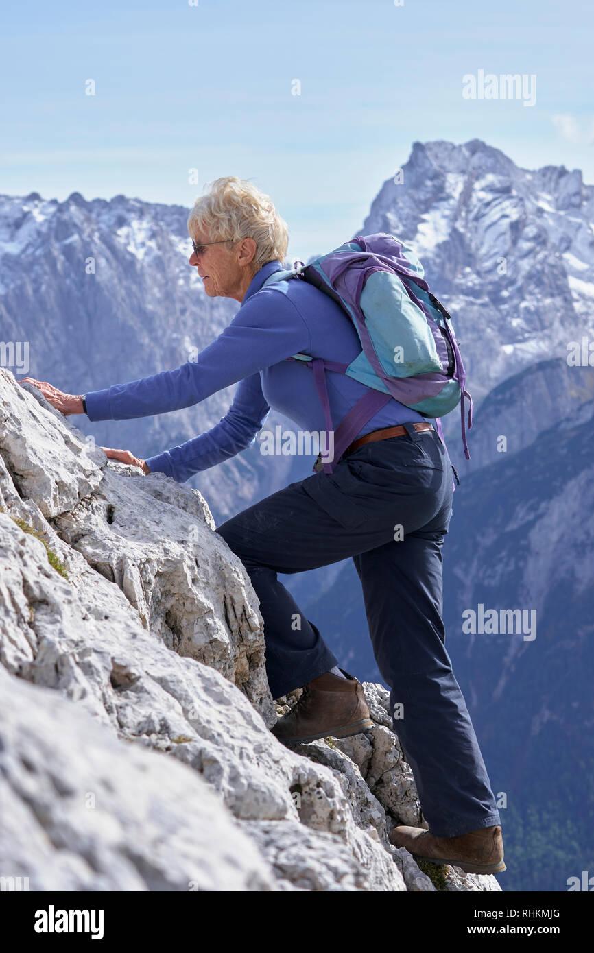 Active senior scrambling in the Dolomites.  Forcella de Popena, near Misurina, Dolomites, Veneto, Italy - Stock Image