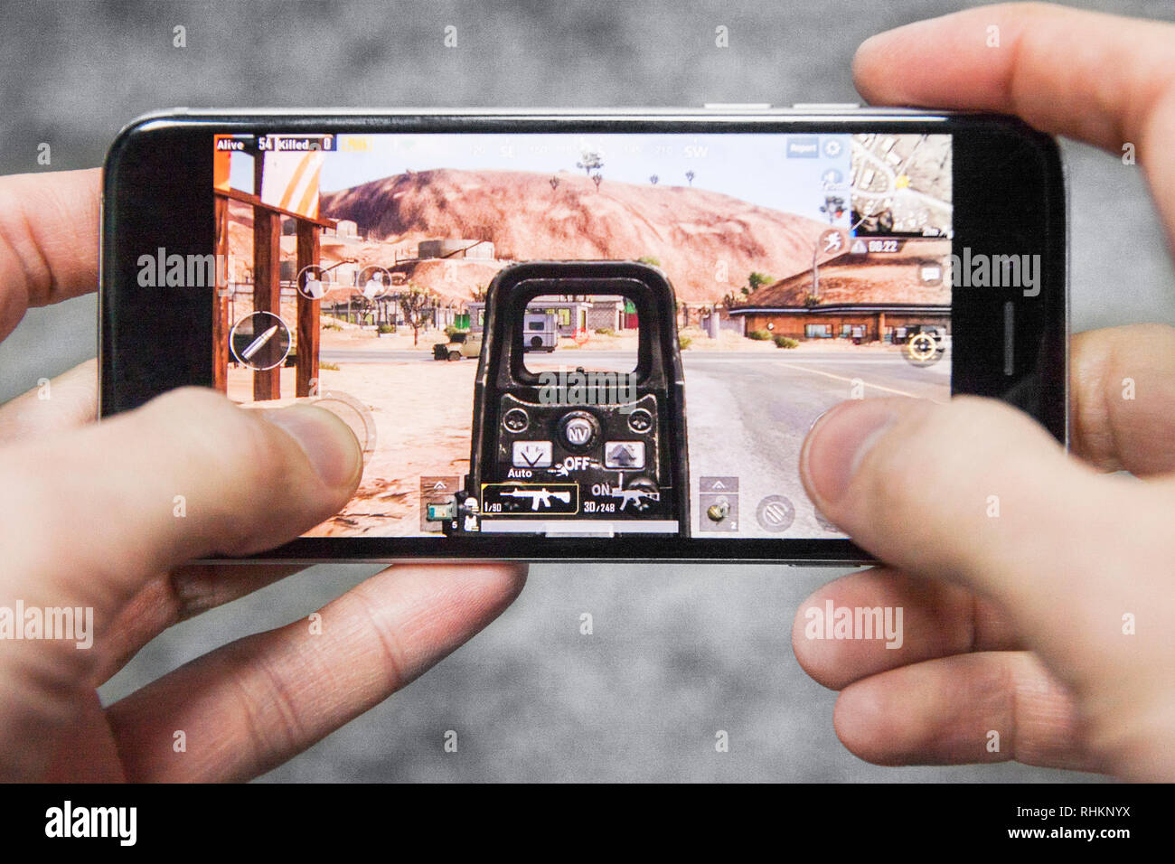 Los Angeles, California, USA - 17 December 2018: Hands holding a smartphone with Player's Unknown Battleground also known as PUBG online shooting FPS  - Stock Image