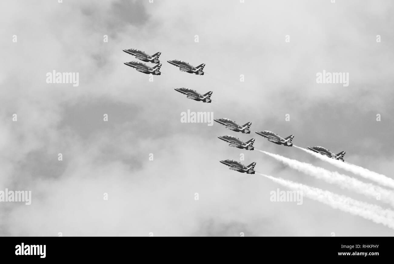 Royal Air Force aerobatic display team the Red Arrows performing at the 2018 Royal International Air Tattoo - Stock Image