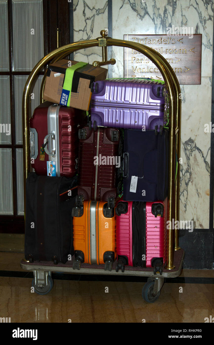 Cases and boxes on a luggage trolley inside a hotel in Zagreb, Croatia - Stock Image