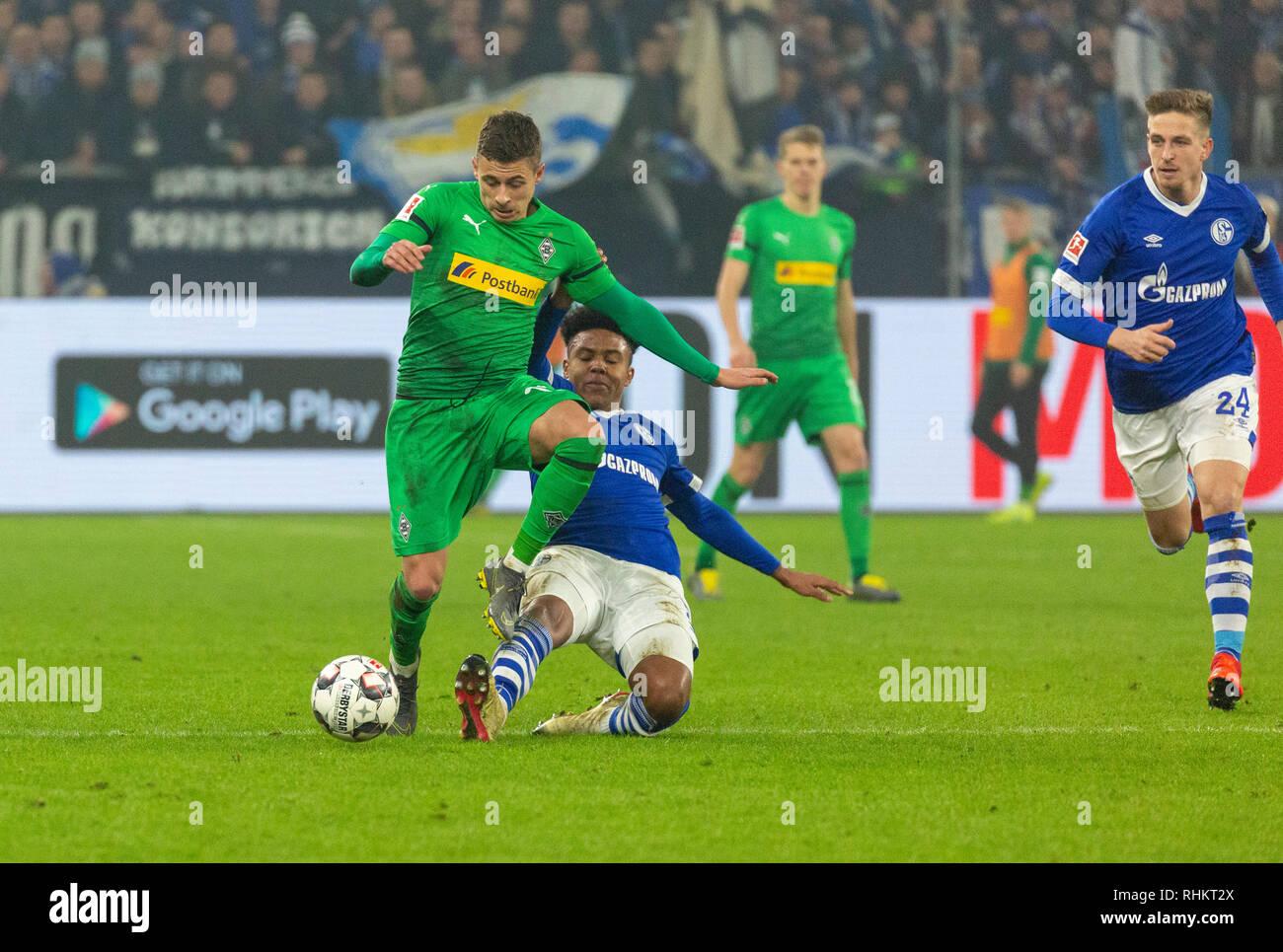 sports, football, Bundesliga, 2018/2019, FC Schalke 04 vs Borussia Moenchengladbach 0-2, Veltins Arena Gelsenkirchen, scene of the match, ahead f.l.t.r. Thorgan Hazard (MG), Weston McKennie (S04), Bastian Oczipka (S04), DFL REGULATIONS PROHIBIT ANY USE OF PHOTOGRAPHS AS IMAGE SEQUENCES AND/OR QUASI-VIDEO - Stock Image