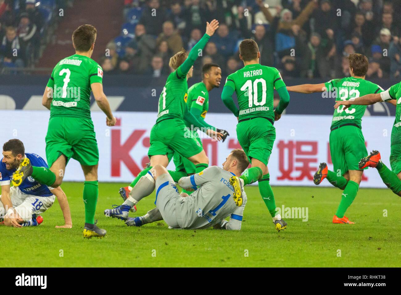 sports, football, Bundesliga, 2018/2019, FC Schalke 04 vs Borussia Moenchengladbach 0-2, Veltins Arena Gelsenkirchen, rejoicing at the 0-2 goal, f.l.t.r. Daniel Caligiuri (S04), Patrick Herrmann (MG), Oscar Wendt (MG), Alassane Plea (MG), goal keeper Ralf Faehrmann (S04), Thorgan Hazard (MG), goal scorer Florian Neuhaus (MG), DFL REGULATIONS PROHIBIT ANY USE OF PHOTOGRAPHS AS IMAGE SEQUENCES AND/OR QUASI-VIDEO - Stock Image